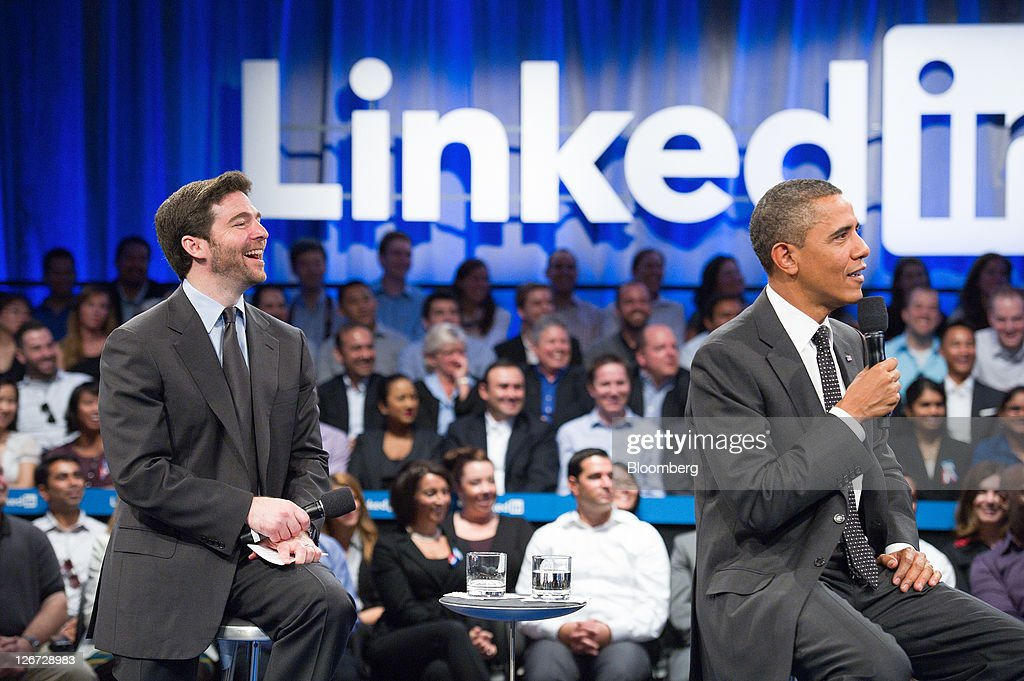 U.S. President Barack Obama, right, speaks while Jeffrey 'Jeff' Weiner, chief executive officer of LinkedIn Corp., laughs during a town hall event sponsored by LinkedIn in Mountain View, California, U.S., on Monday, Sept. 26, 2011. Obama said his $447 billion jobs proposal will give the U.S. economy the 'jump start' it needs to revive job growth. Photographer: David Paul Morris/Bloomberg via Getty Images