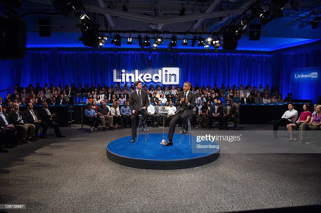 U.S. President Barack Obama, right, speaks while Jeffrey 'Jeff' Weiner, chief executive officer of LinkedIn Corp., listens during a town hall event sponsored by LinkedIn in Mountain View, California, U.S., on Monday, Sept. 26, 2011. Obama said his $447 billion jobs proposal will give the U.S. economy the 'jump start' it needs to revive job growth. Photographer: David Paul Morris/Bloomberg via Getty Images