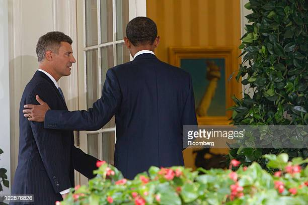 US President Barack Obama right walks into the Oval Office with Alan Krueger after announcing Krueger as a nominee to lead the White House Council of...