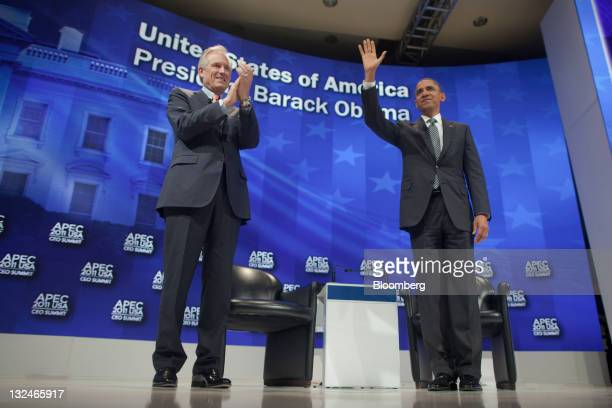 President Barack Obama, right, waves before talking with James McNerney, chief executive officer of Boeing Co., during the Asia-Pacific Economic...