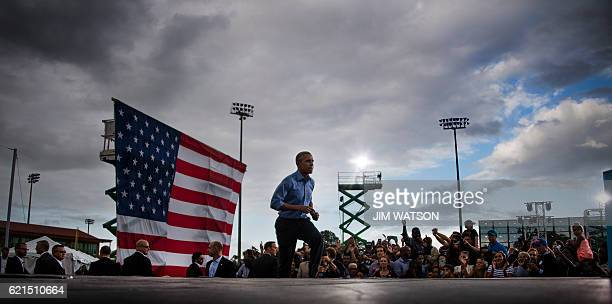 US President Barack Obama runs on stage before speaking in Kissimmee Florida November 6 2016 as he campaigns for Democratic presidential nominee...
