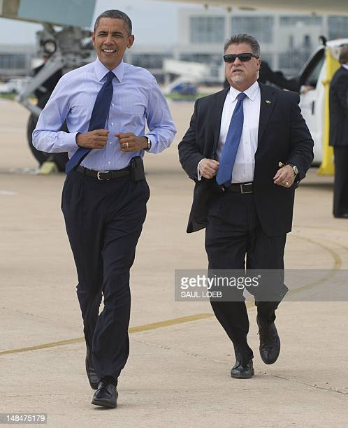 US President Barack Obama runs to greet wellwishers upon arrival on Air Force One at AustinBergstrom International Airport in Austin Texas on July 17...