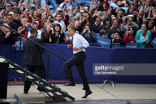S President Barack Obama runs up stairs to the stage during a campaign rally at Elm Street Middle School October 27 2012 in Nashua New Hampshire With...