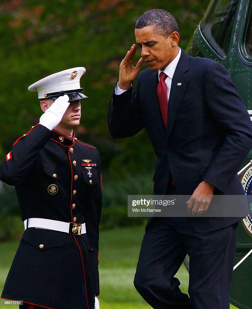 U.S. President Barack Obama (R) salutes a U.S. Marine he returns to the White House April 20, 2010 in Washington, DC. Obama was returning from a trip to California.
