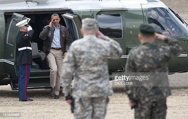 US President Barack Obama salutes from Marine One upon arrival at army base Camp Bonifas in Paju during a visit to the Demilitarized Zone on the...