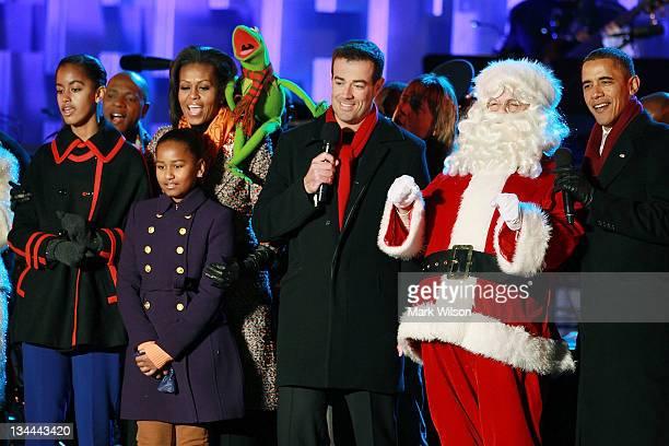 President Barack Obama Santa Clause Carson Daly Kermit the Frog first lady Michelle Obama and daughters Sasha and Malia sing a song during the...