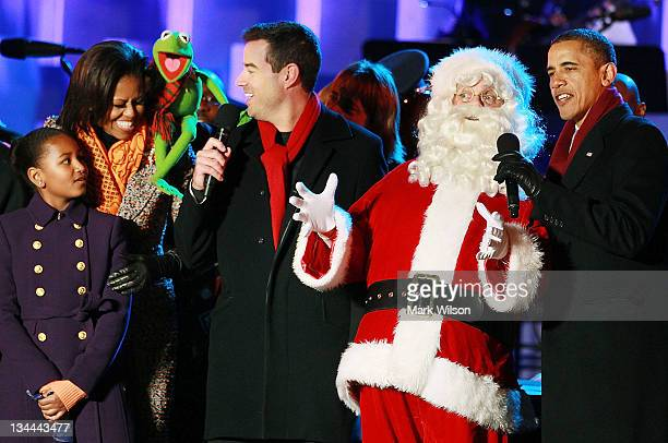 S President Barack Obama Santa Clause Carson Daly Kermit the Frog first lady Michelle Obama and daughter Sasha sing a song during the National...