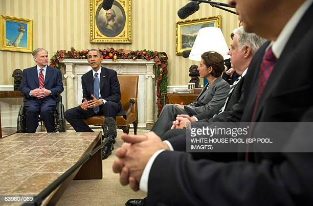 President Barack Obama seated next to Governorelect Greg Abbott speaks to reporters as he meets with newly elected governors in the Oval Office of...