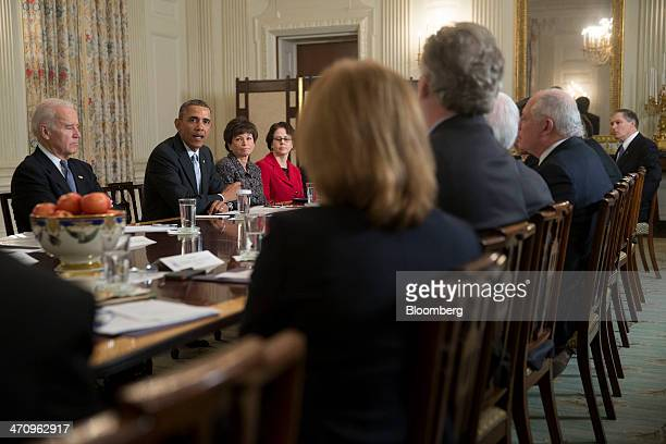 US President Barack Obama second from left speaks while meeting with members of the Democratic Governors Association in the State Dining Room along...
