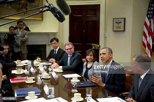 US President Barack Obama second from right speaks during a meeting with business executives including Byeong Jin Lee senior vice president and chief...
