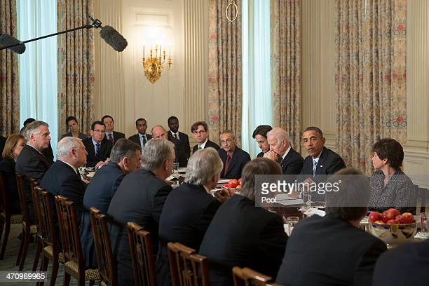 S President Barack Obama second from right speaks while meeting with members of the Democratic Governors Association in the State Dining Room with...