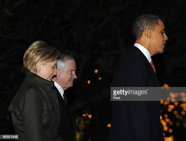 S President Barack Obama Secretary of State Hillary Clinton and Defense Secretary Robert Gates walk across the South Lawn of the White House to board...