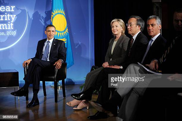 US President Barack Obama Secretary of State Hillary Clinton Energy Secretary Steven Chu and White House Chief of Staff Rahm Emanuel look on during a...