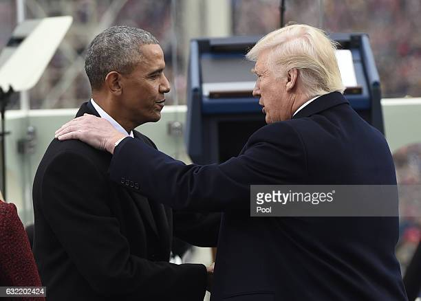 President Barack Obama shake hands with Presidentelect Donald Trump during the Presidential Inauguration at the US Capitol on January 20 2017 in...