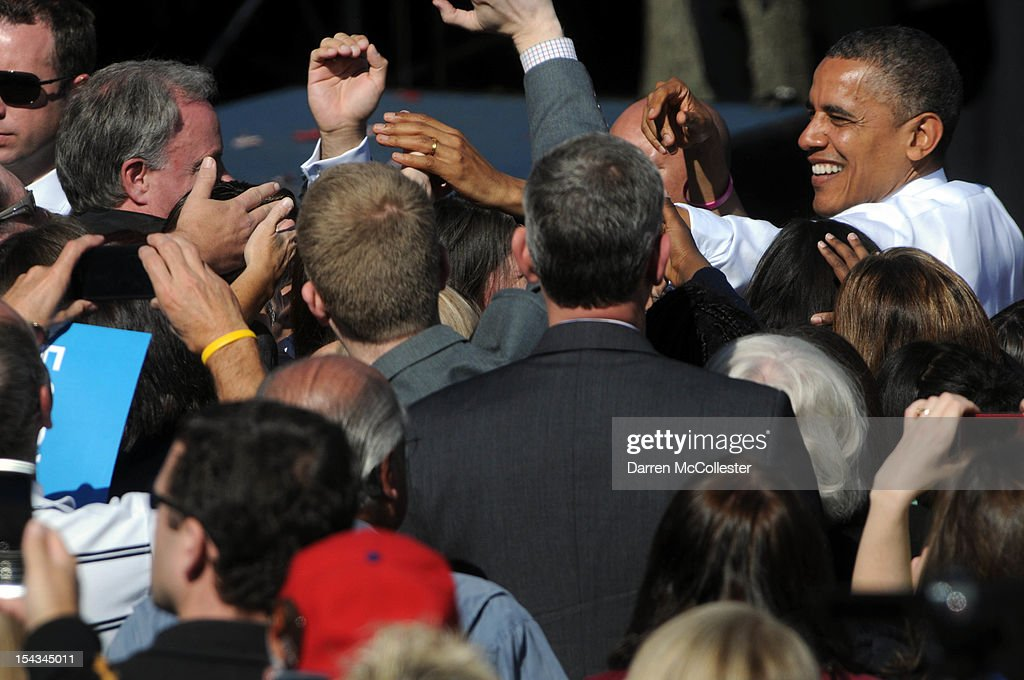 President Barack Obama shakes hands after speaking at an event at Veteran's Memorial Park October 18, 2012 in Manchester, New Hampshire. President Obama continues to campaign in swing states with just under three weeks left till Election Day.