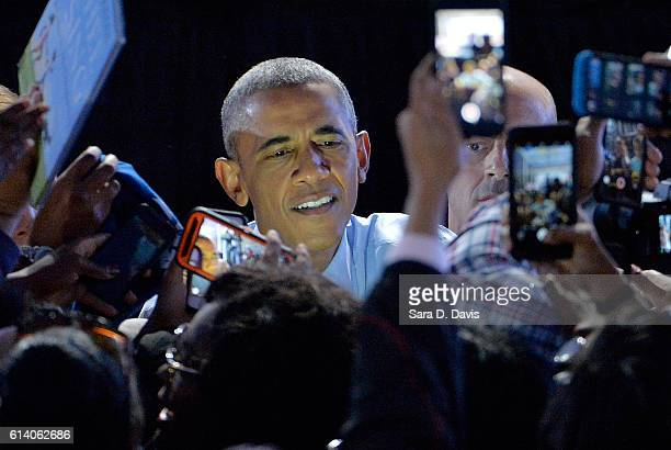 President Barack Obama shakes hands along the rope line after a campaign event for Democratic presidential nominee Hillary Clinton on October 11,...