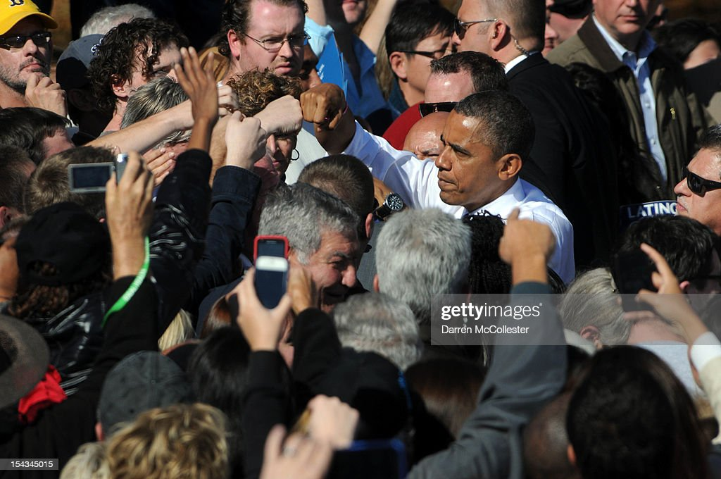 President Barack Obama shakes hands at an event at Veteran's Memorial Park October 18, 2012 in Manchester, New Hampshire. President Obama continues to campaign in swing states with just under three weeks left till Election Day.