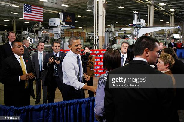S President Barack Obama shakes hands at The Rodon Group manufacturing facility on November 30 2012 in Hatfield Pennsylvania Obama made a case for...