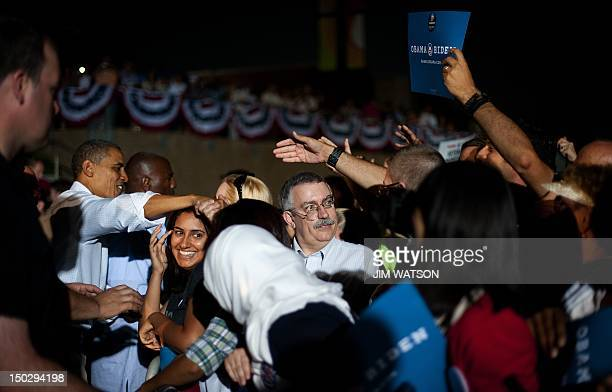 US President Barack Obama shakes hands wi th supporters after delivering remarks at Waterloo Center for the Arts in Waterloo Iowa August 14 2012...