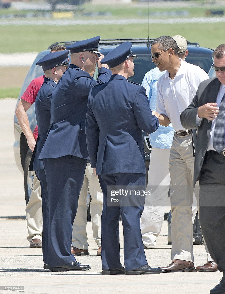 U.S. President Barack Obama shakes hands with a group of U.S. Air Force officers as he prepares to board Marine 1 to depart Joint Base Andrews enroute to Camp David on July 5, 2013 near Camp Springs, Maryland. Obama is heading to Camp David following a round of golf.
