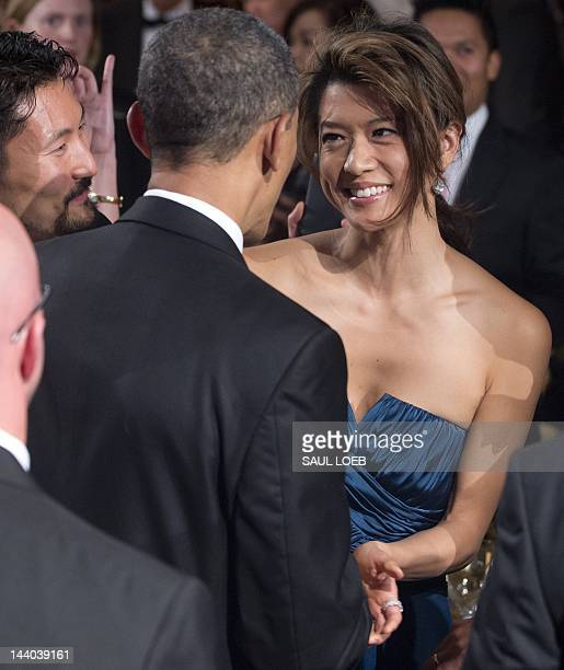 President Barack Obama shakes hands with actress Grace Park from television's Hawaii Five-O after speaking at the Asian Pacific American Institute...