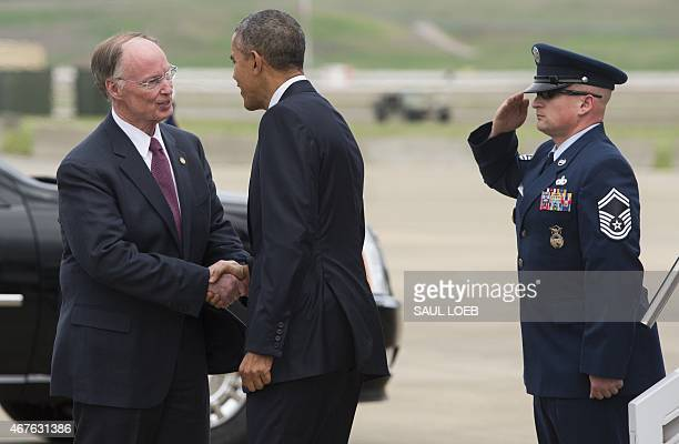US President Barack Obama shakes hands with Alabama Governor Robert Bentley upon arrival on Air Force One at BirminghamShuttlesworth International...