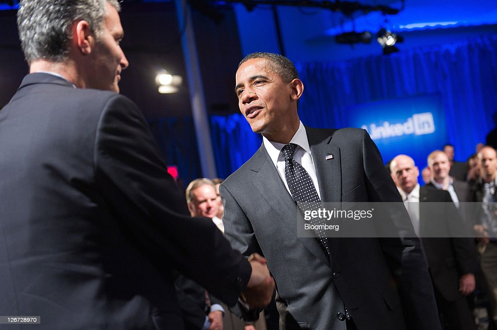 U.S. President Barack Obama shakes hands with an audience member during a town hall event sponsored by LinkedIn Corp. in Mountain View, California, U.S., on Monday, Sept. 26, 2011. Obama said his $447 billion jobs proposal will give the U.S. economy the 'jump start' it needs to revive job growth. Photographer: David Paul Morris/Bloomberg via Getty Images