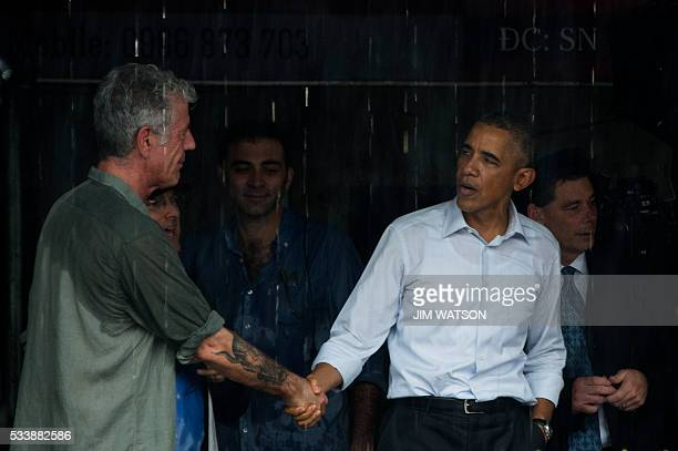 US President Barack Obama shakes hands with Anthony Boudain a chef and food critic who fronts a travel show about hidden culinary gems around the...