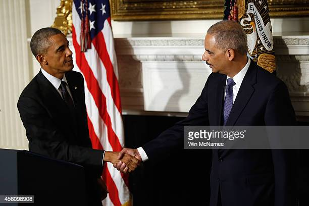 President Barack Obama shakes hands with Attorney General Eric H Holder Jr who announced his resignation today September 25 2014 in Washington DC...