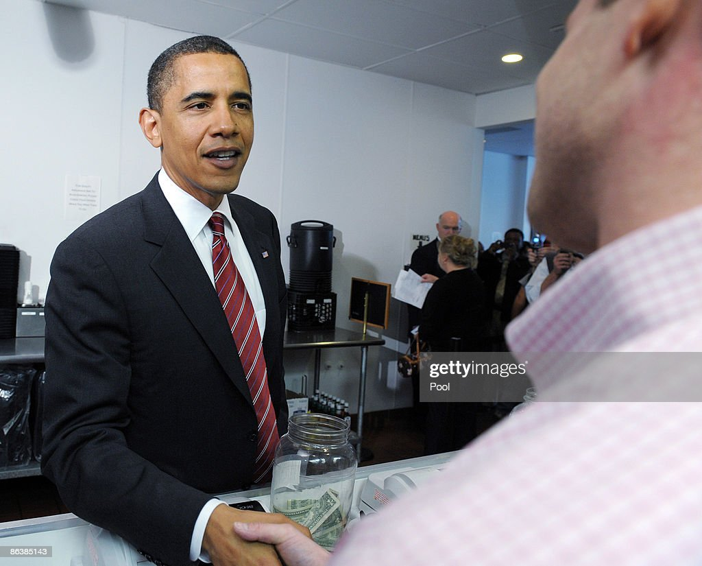 U.S. President Barack Obama shakes hands with cashier Tim Murray as he orders lunch at Ray's Hell Burger May 5, 2009 in Arlington, Virginia. Obama and Biden made an unannouced vist to the Arlington restaurant.