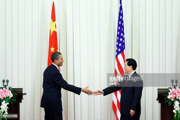 US President Barack Obama shakes hands with Chinese President Hu Jintaoafter a joint press conference at the Great Hall of People on November 17 2009...