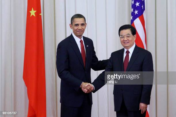 President Barack Obama shakes hands with Chinese President Hu Jintao after a joint press conference at the Great Hall of People on November 17, 2009...