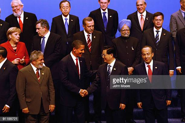 President Barack Obama shakes hands with Chinese President Hujin Tao after posing for the official group photo at the G-20 as Director General of the...