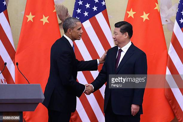 S President Barack Obama shakes hands with Chinese President Xi Jinping after a joint press conference at the Great Hall of People on November 12...