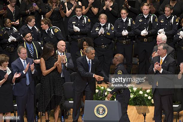 S President Barack Obama shakes hands with Dallas Police Chief David Brown during a memorial service for the victims of the Dallas police shooting at...