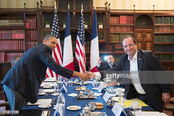 US President Barack Obama shakes hands with French President Francois Hollande during a bilateral meeting on the sidelines of the G8 summit in the...