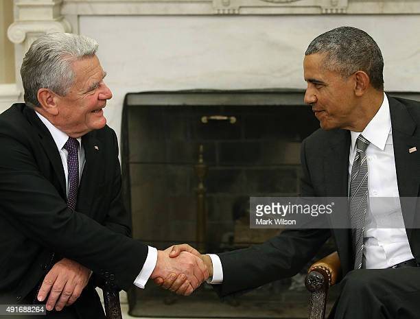 President Barack Obama shakes hands with German President Joachim Gauck during a meeting in the Oval Office at the White House October 7, 2015 in...