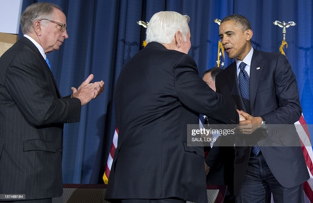 US President Barack Obama shakes hands with Indiana Republican Senator Richard Lugar (C) and former Georgia Democratic Senator Sam Nunn (L) during the Nunn-Lugar Cooperative Threat Reduction (CTR) symposium at the National Defense University in Washington on December 3, 2012. Obama directly warned Syria's President Bashar al-Assad that he would face 'consequences' if he made the 'tragic mistake' of turning chemical weapons on his own people. AFP PHOTO / Saul LOEB
