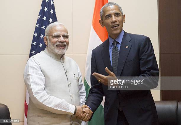 President Barack Obama shakes hands with India's Prime Minister Narendra Modi prior to a meeting on the sidelines of the Association of Southeast...