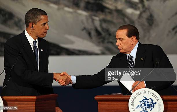 President Barack Obama shakes hands with Italian Prime Minister Silvio Berlusconi at a press conference following the Major Economic Forum meeting...