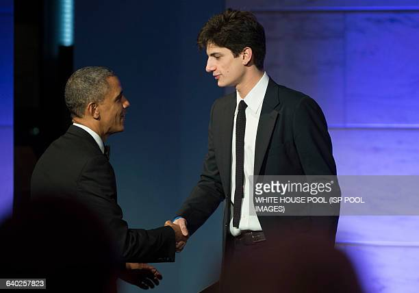 President Barack Obama shakes hands with Jack Schlossberg the Grandson of President John F Kennedy after he introduced Obama during a dinner in honor...
