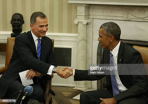 S President Barack Obama shakes hands with King Felipe VI of Spain during a bilateral meeting in the Oval Office at the White House September 15 2015...