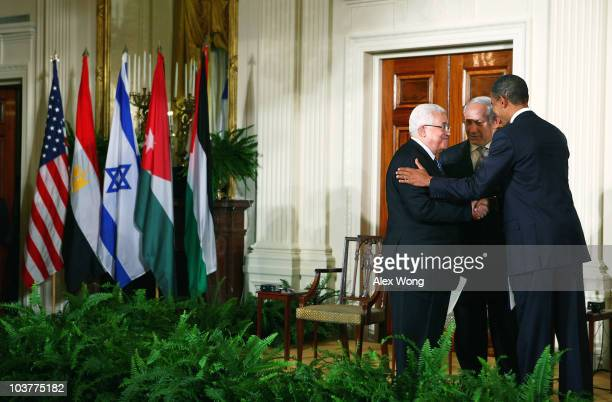 S President Barack Obama shakes hands with Palestinian Authority President Mahmoud Abbas as Israeli Prime Minister Benjamin Netanyahu looks on at the...