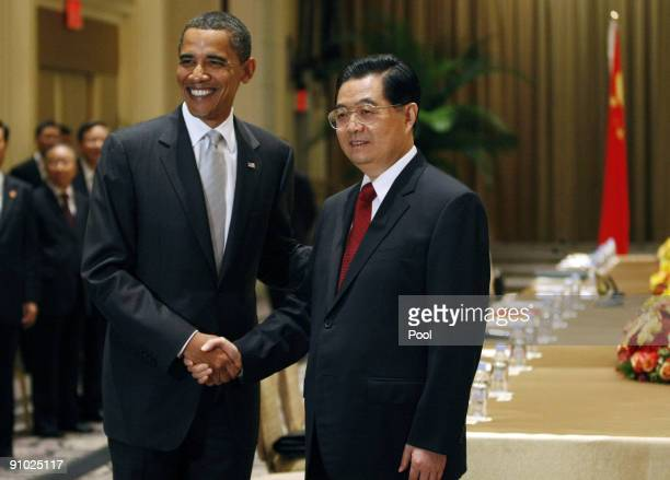 President Barack Obama shakes hands with President Hu Jintao of China at a bilateral meeting at the Waldorf Astoria Hotel on September 22, 2009 in...