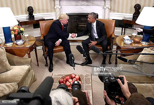 S President Barack Obama shakes hands with Presidentelect Donald Trump following a meeting in the Oval Office November 10 2016 in Washington DC Trump...