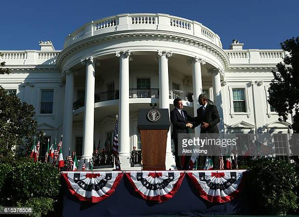 S President Barack Obama shakes hands with Prime Minister of Italy Matteo Renzi during an official arrival ceremony on the South Lawn of the White...