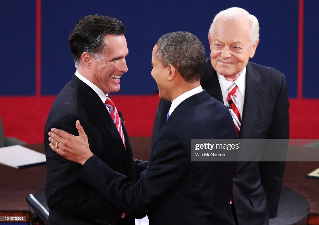 U.S. President Barack Obama (R) shakes hands with Republican presidential candidate Mitt Romney as moderator Bob Schieffer of CBS looks on at the Keith C. and Elaine Johnson Wold Performing Arts Center at Lynn University on October 22, 2012 in Boca Raton, Florida. The focus for the final presidential debate before Election Day on November 6 is foreign policy.