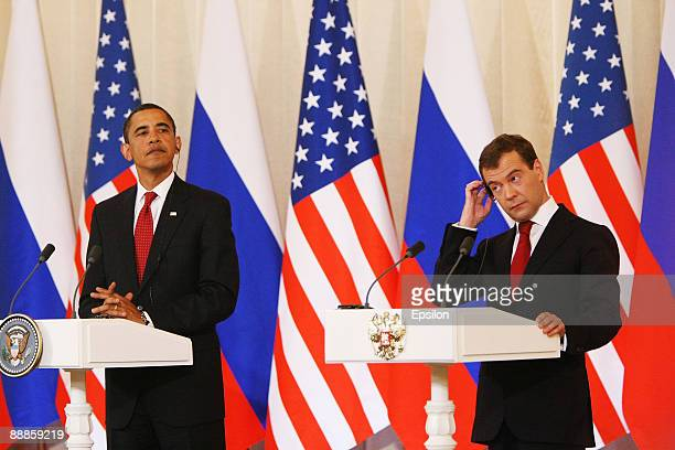 S President Barack Obama shakes hands with Russian President Dmitry Medvedev as they hold their press conference after the signing ceremony of the...