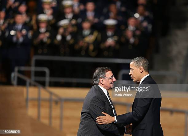 S President Barack Obama shakes hands with Secretary of Defense Leon Panetta during an Armed Service farewell ceremony for Sec Panetta at Joint Base...