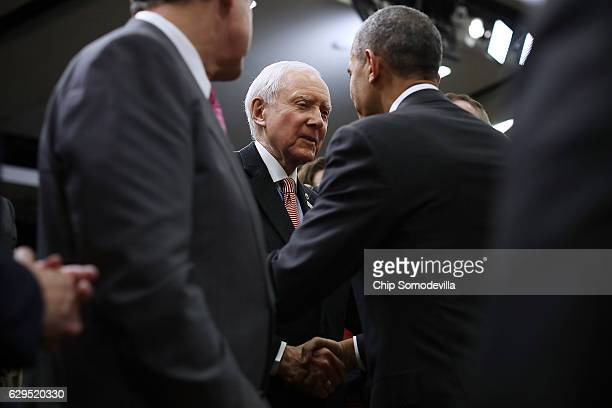 S President Barack Obama shakes hands with Sen Orrin Hatch after signing the 21st Century Cures Act into law at the Eisenhower Executive Office...